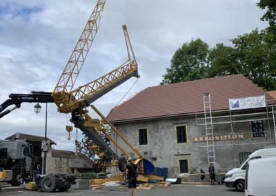 Grue de couvreur pour construction toiture et montage maison passive à chambéry